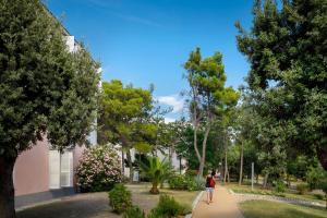 A garden outside San Marino Sunny Resort by Valamar
