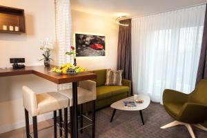 Ein Sitzbereich in der Unterkunft Best Western Hotel Hohenzollern