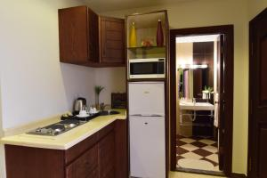 A cozinha ou cozinha compacta de Al Balad Inn Al Mishkat