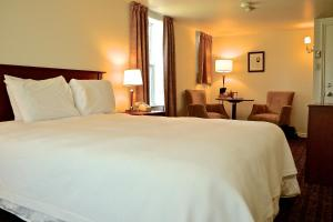 A bed or beds in a room at Inverary Resort