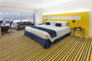 A bed or beds in a room at Wyndham Bogota