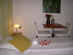 Postel nebo postele na pokoji v ubytování Rezidence Fami Deluxe Design