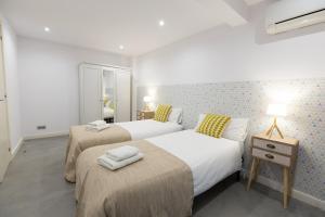 Posteľ alebo postele v izbe v ubytovaní Weflating Park Güell