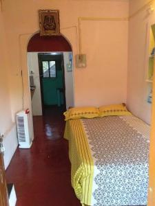 A bed or beds in a room at Om Ganapati Stay home