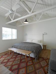 A bed or beds in a room at The Oyster Inn