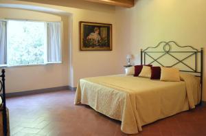 Letto o letti in una camera di Relais Villa Poschi