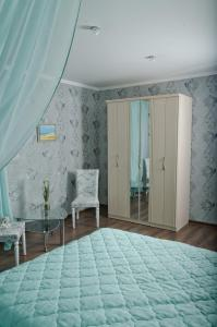 A bed or beds in a room at Dunenblick