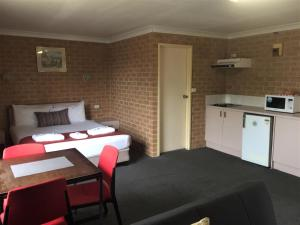 A bed or beds in a room at Huskisson Bayside Resort
