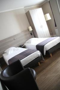 Een bed of bedden in een kamer bij Arriate Hotel