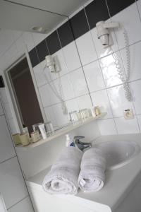Een badkamer bij Arriate Hotel