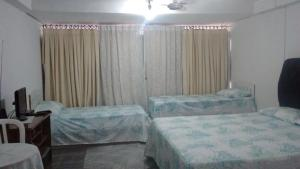 Cama ou camas em um quarto em Pousada Ana Poipa