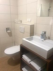 Ein Badezimmer in der Unterkunft Schnepfenhof