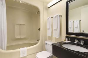 A bathroom at Days Inn by Wyndham Kenora