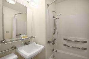 A bathroom at Days Inn by Wyndham Oglesby/ Starved Rock