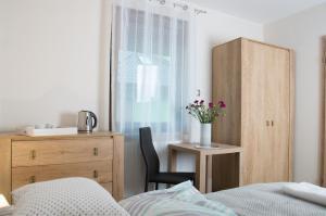 Ein Bett oder Betten in einem Zimmer der Unterkunft Dom Wakacyjny ODSAPKA