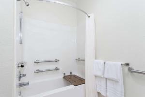 A bathroom at Days Inn by Wyndham near Kansas Speedway