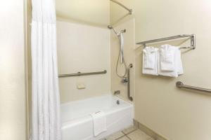 A bathroom at Days Inn by Wyndham Colorado Springs Airport
