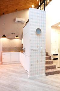 Kuchnia lub aneks kuchenny w obiekcie Sun House Apartament z SAUNĄ