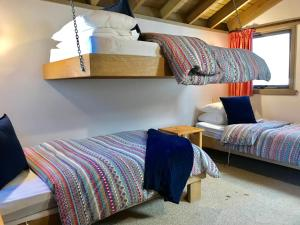 A bunk bed or bunk beds in a room at Bindi - Alpine Getaways's Chalet at Tower Rd