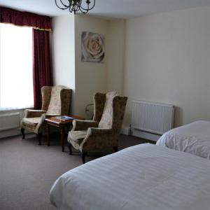 A bed or beds in a room at Cae Mor; Sure Hotel Collection by Best Western