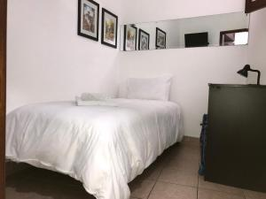 A bed or beds in a room at Larq'a Park Rooms