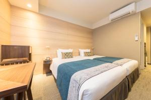 A bed or beds in a room at Tokyu Stay Sapporo