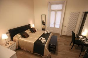 A bed or beds in a room at B&B Il Ritratto