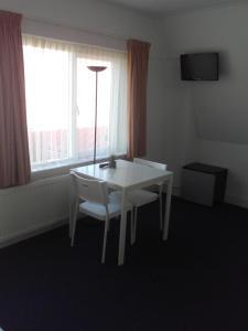 Télévision ou salle de divertissement dans l'établissement Kamerverhuur Mossels&Meer
