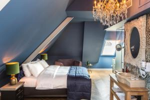 A bed or beds in a room at Boutiquehotel 't Gerecht
