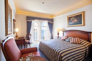 Łóżko lub łóżka w pokoju w obiekcie Grand Villa Argentina