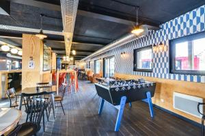 A restaurant or other place to eat at Eklo Hotels Lille