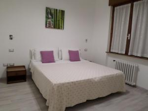 A bed or beds in a room at Villa Ester