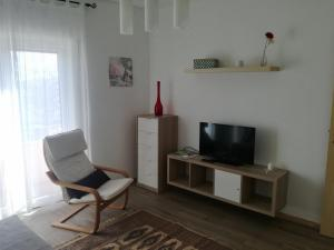 A television and/or entertainment center at Carmo Twenties Apartment