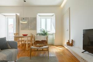 Coin salon dans l'établissement Dona Graca Lisbon Apartments