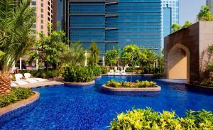 The swimming pool at or near Conrad Dubai