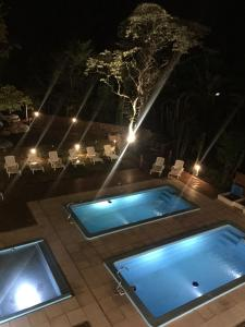 A view of the pool at Apart Hotel La Giraldilla or nearby
