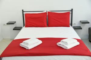 Łóżko lub łóżka w pokoju w obiekcie City Heart Luxury Studios