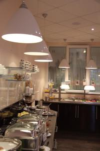 A restaurant or other place to eat at Adena Hotel