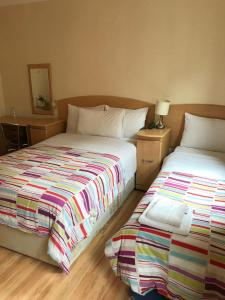 A bed or beds in a room at Seven Dials Hotel