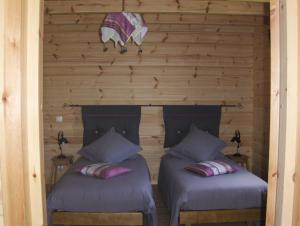 Un ou plusieurs lits dans un hébergement de l'établissement Les Bruchels, Longechaux