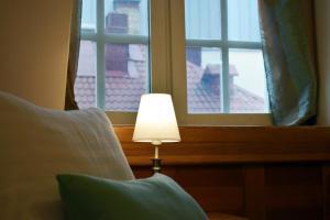 Ein Bett oder Betten in einem Zimmer der Unterkunft Boutique Hotel KRISTOFS