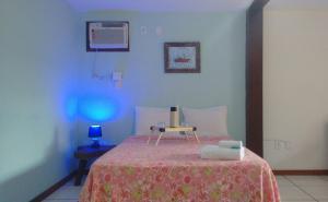 Cama ou camas em um quarto em Biruta Guest House