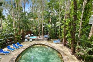 The swimming pool at or near The Reef Retreat Palm Cove