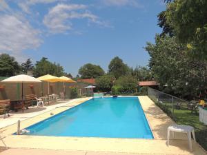 The swimming pool at or near Posada Aymara