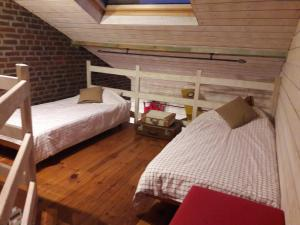 A bed or beds in a room at B&B Le Bonimenteur