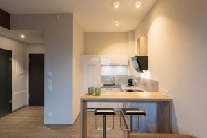 Küche/Küchenzeile in der Unterkunft DECK 8 DESIGNHOTEL.SOEST