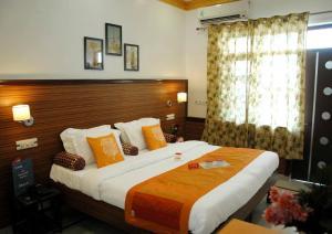Cama o camas de una habitación en Hotel Harmony