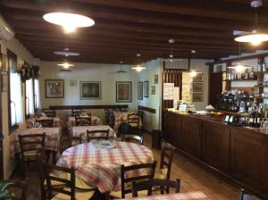 A restaurant or other place to eat at Osteria La Pesa