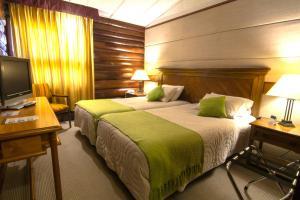 Cama o camas de una habitación en Panamericana Hotel Ancud