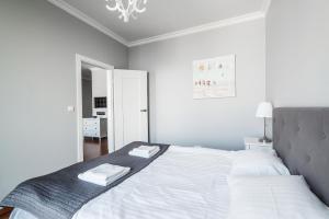 Łóżko lub łóżka w pokoju w obiekcie Triton Park Apartments